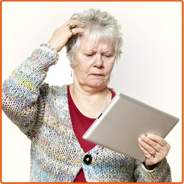 Older adult puzzled by iPad