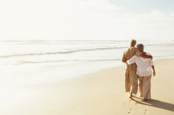 Elderly Couple on Beach Contemplating Home Safety