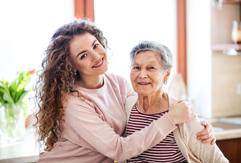 Daughter hugging Grandma at Care Home