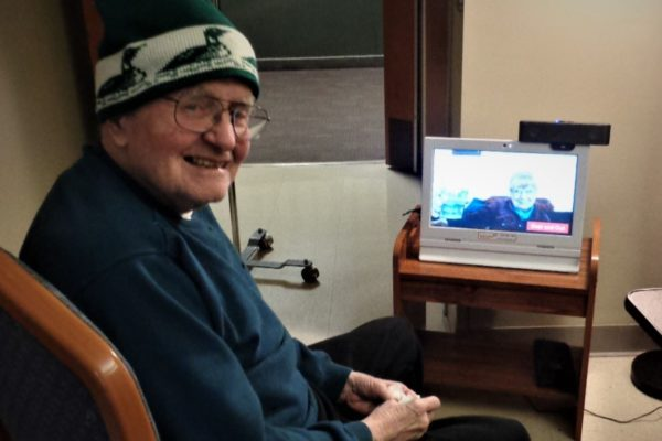 Jack and Tillie North America using Videophone